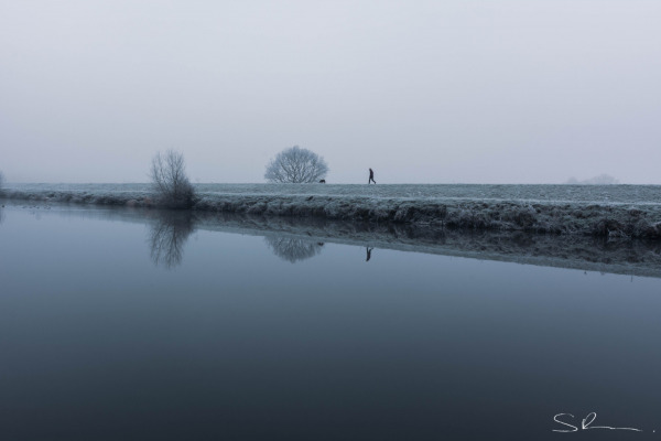 Lady with dog on cold winter morning