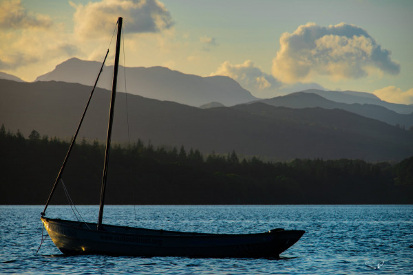 Boat on Windermere at sunset